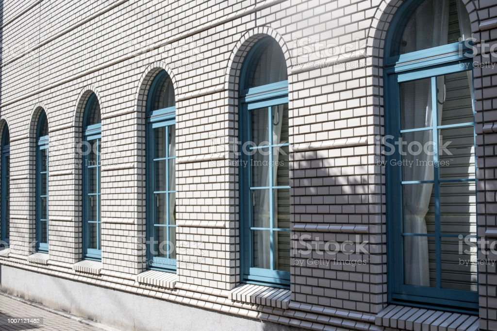 Brick House Windows with rolling shutter stock photo