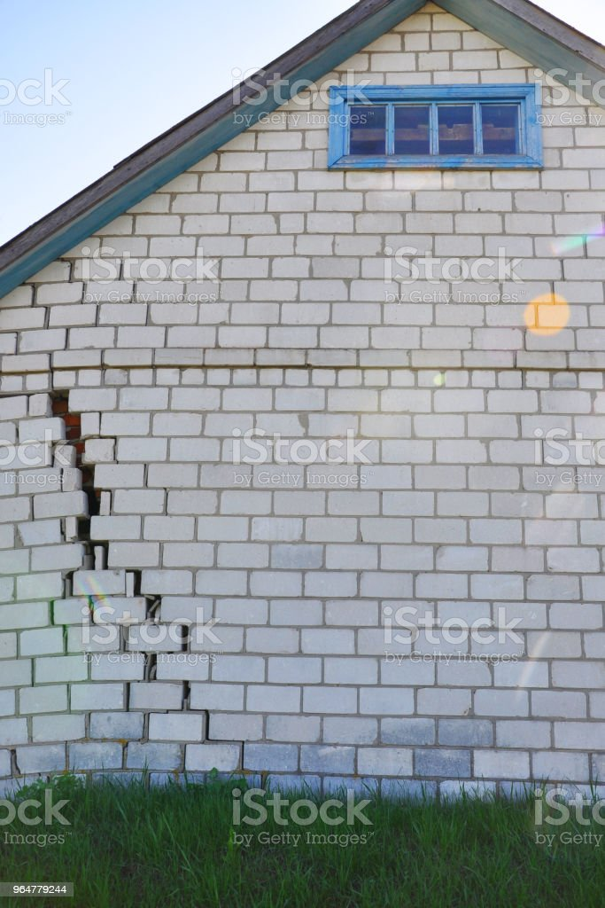 Brick house with a crack for your design royalty-free stock photo