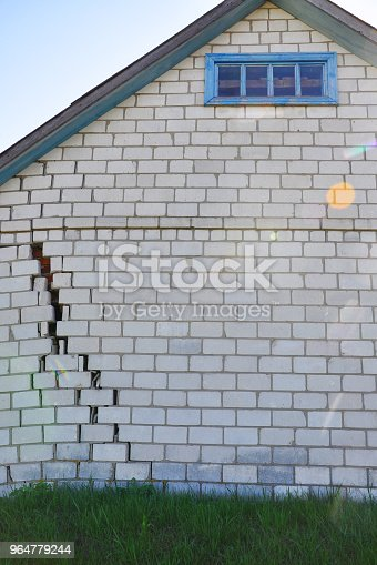 Brick House With A Crack For Your Design Stock Photo & More Pictures of Abandoned