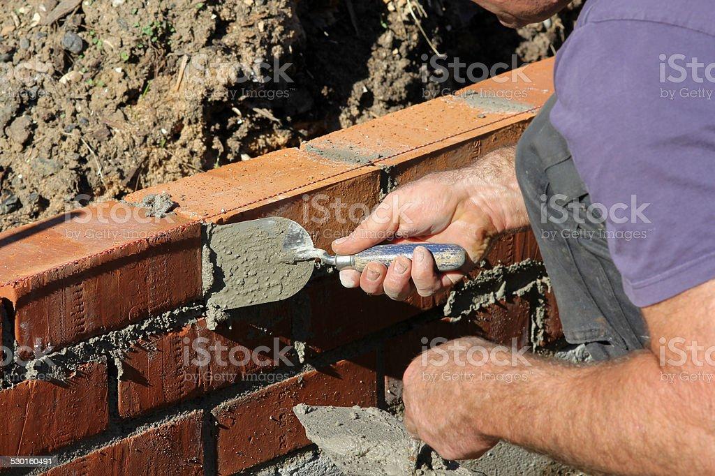 Brick layer stock photo