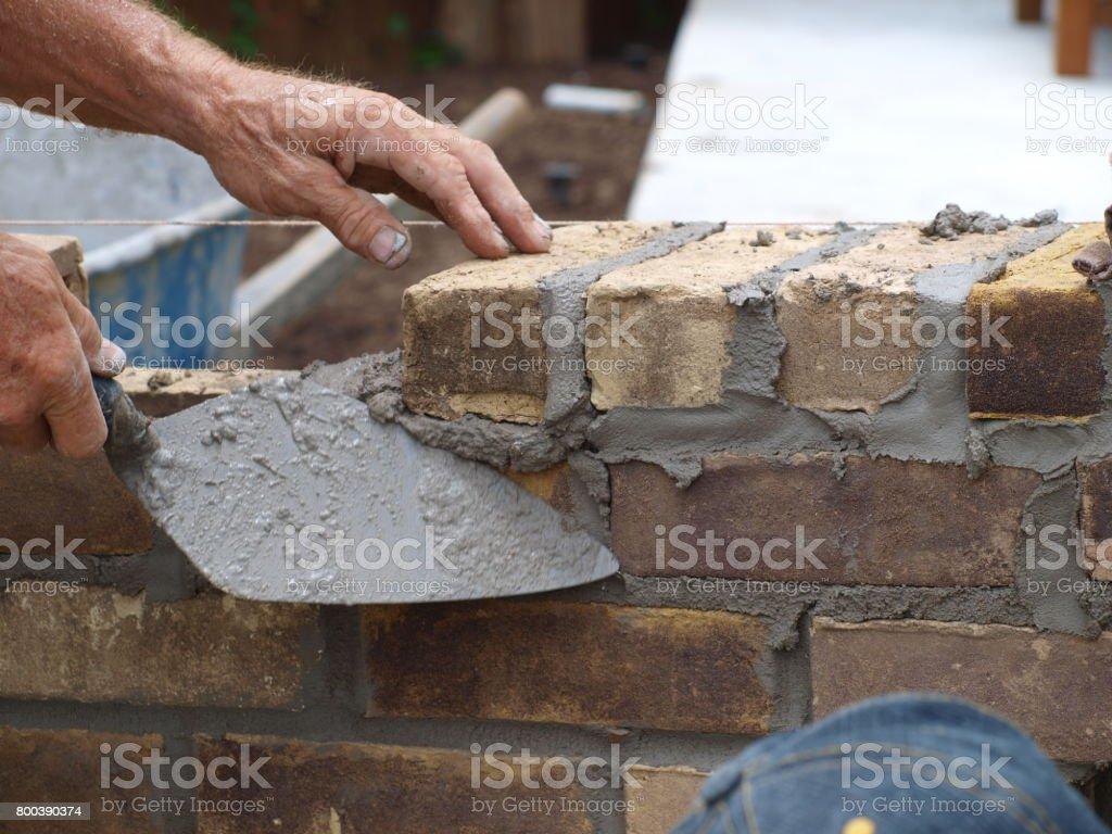 A brick mason's tool is the trowel. stock photo