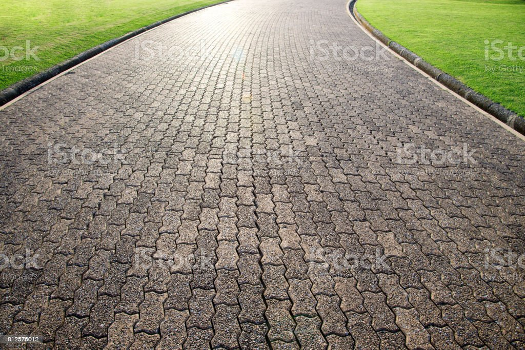 Brick octagona walkway and green grass lawn in perspective view stock photo