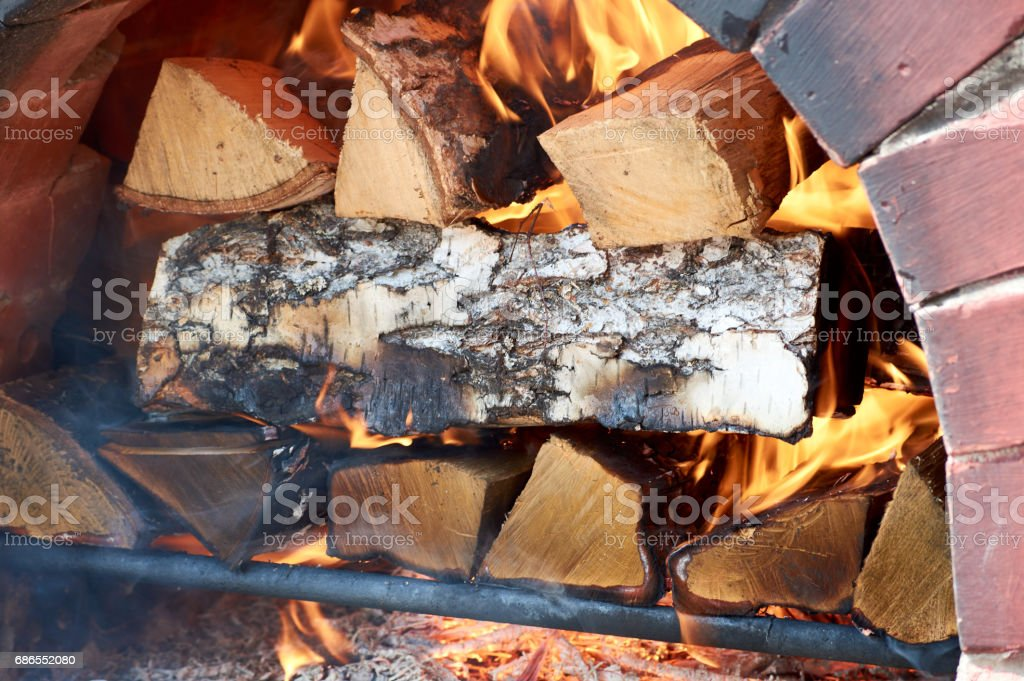 Brick oven with fire and woods royalty-free stock photo