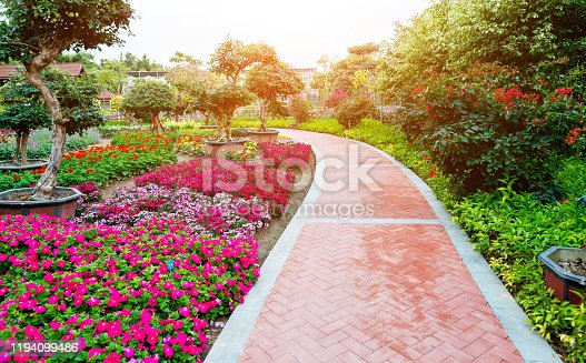Brick path and flowerbeds in the park.