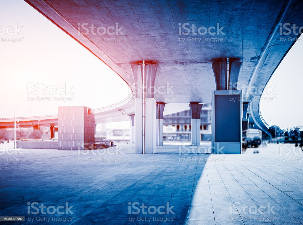 brick pavement under overpass stock photo