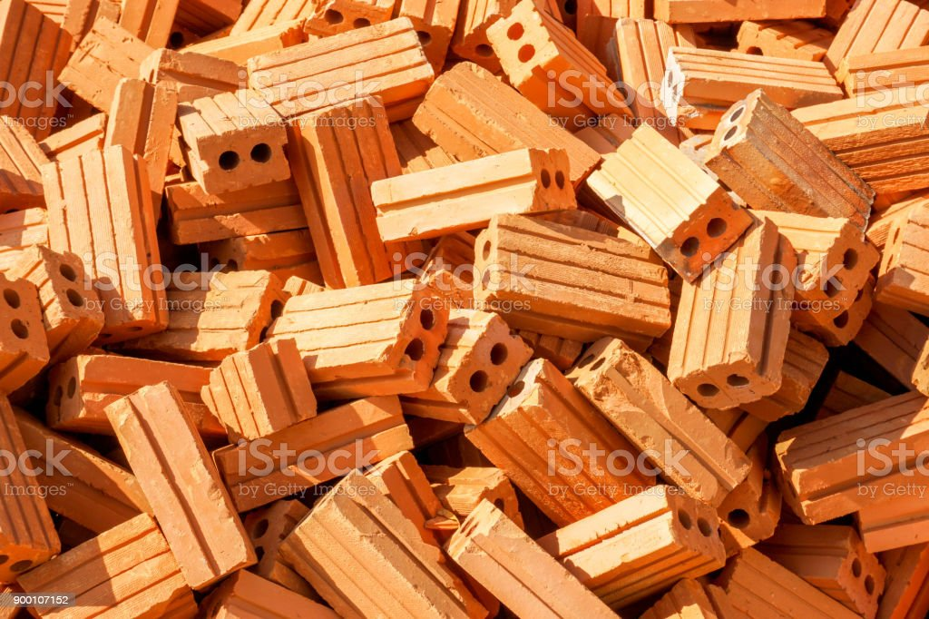 Brick pile background and wallpaper at construction site. stock photo