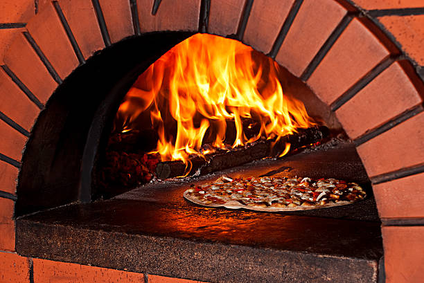 Brick Pizza Oven in Flames stock photo