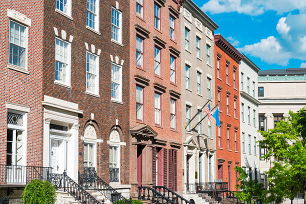 Brick Row Houses in Albany New York State USA Photo of old, colorful, brick townhouses in downtown Albany, New York State, USA albany county new york state stock pictures, royalty-free photos & images