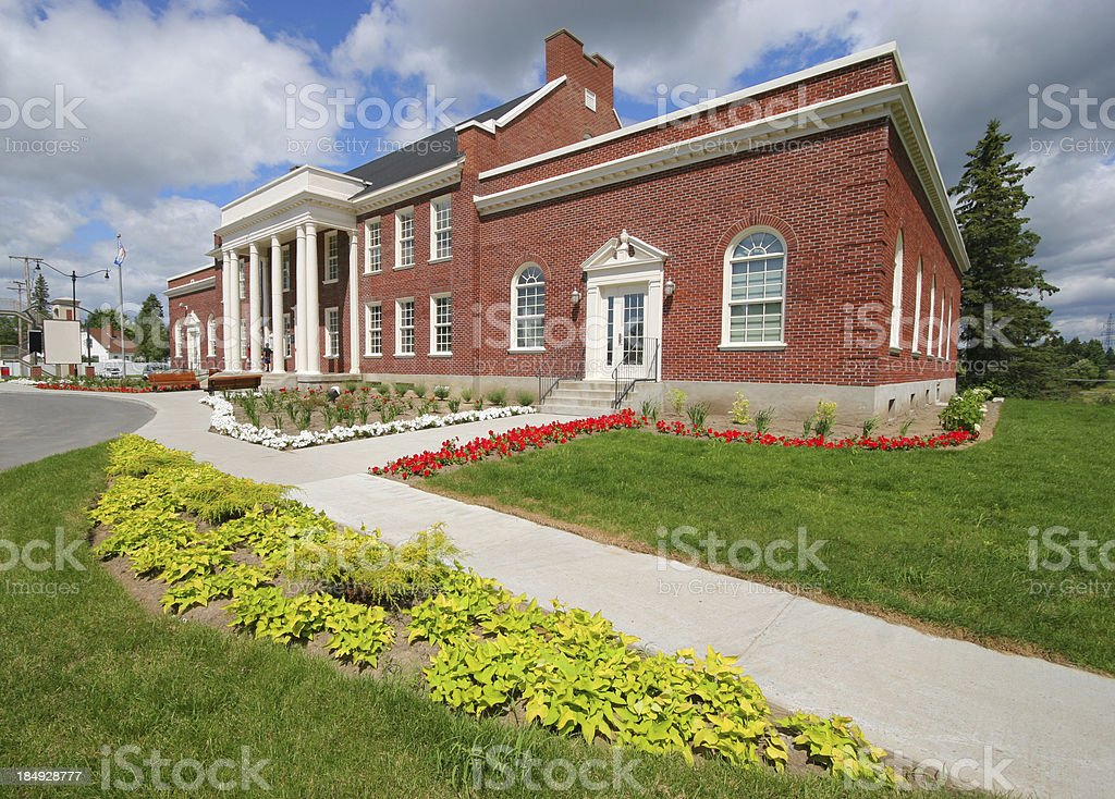 Brick School building with columns and flowers arrangement royalty-free stock photo