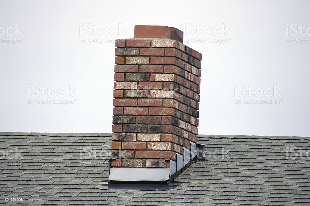 A brick small chimney on a roof stock photo