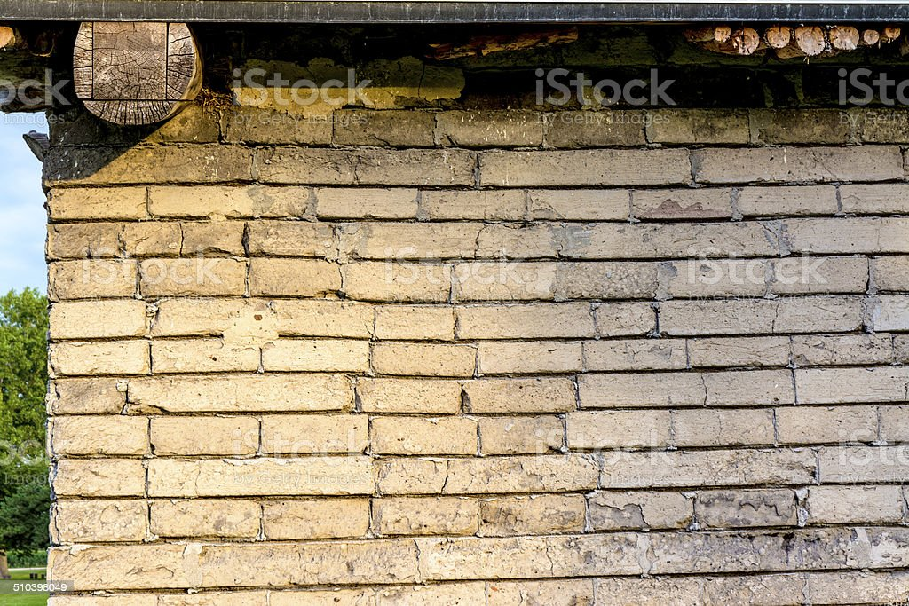 Brick stone wall of an old rustic cabin stock photo