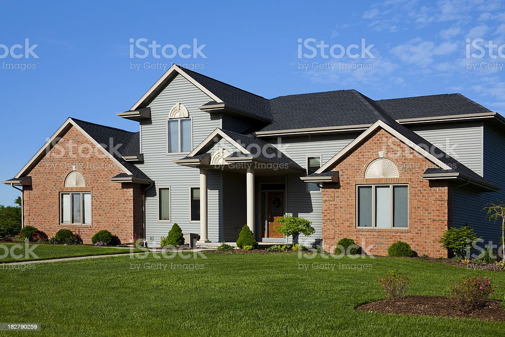 Brick, Vinyl Home Design With Mixed Textures and Colors stock photo