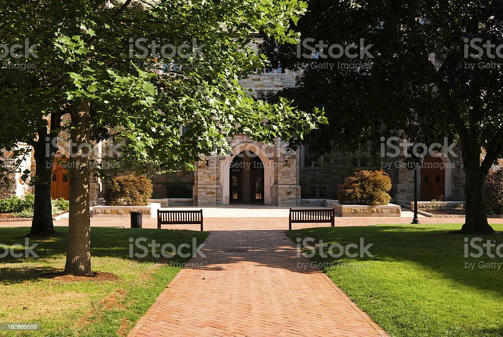 Brick walkway leading to educational building at Boston College stock photo