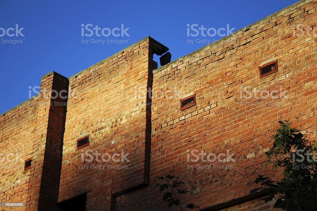 Brick wall and blue sky at sunset royalty-free stock photo