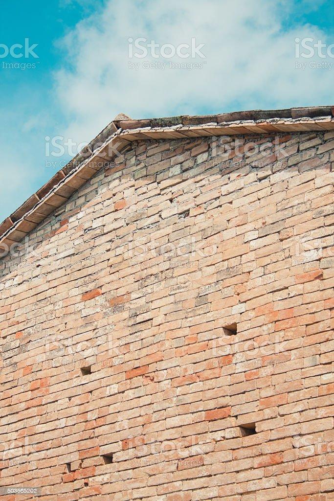 Brick wall and blue sky stock photo