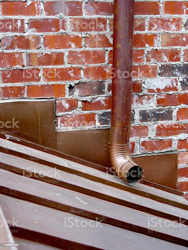 brick wall and drain pipe royalty-free stock photo