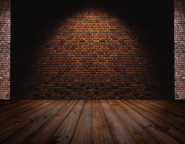 Brick wall and Hardwood floor, light spot on center for background stock photo