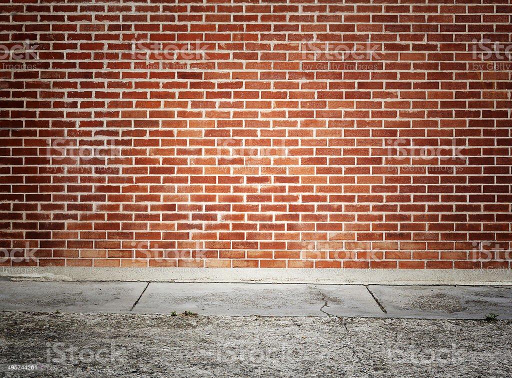 Brick Wall And Sidewalk Royalty Free Stock Photo