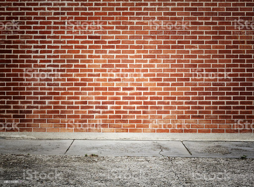 Brick Wall And Sidewalk stock photo