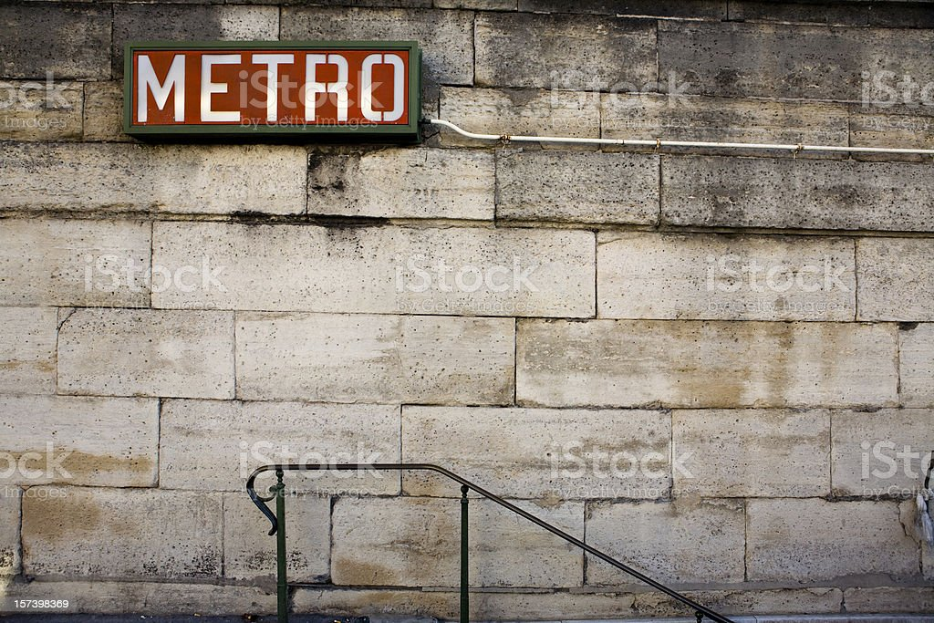 Brick wall and slope with a red Metro Sign on top stock photo