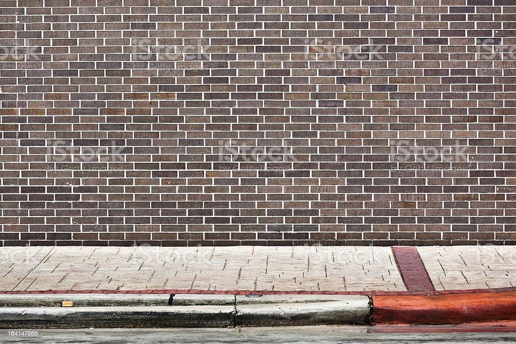 Brick wall and walkway background stock photo