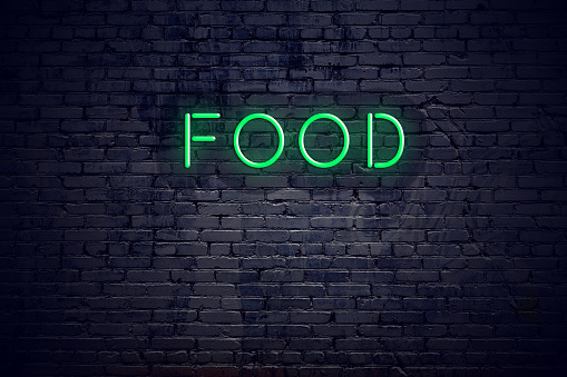 Brick Wall At Night With Neon Sign Food Stock Photo - Download Image Now