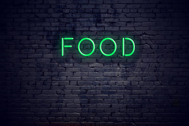 Brick wall at night with neon sign food