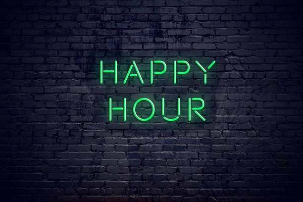 Brick wall at night with neon sign happy hour