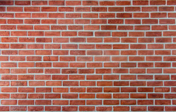 벽돌 벽 배경입니다. 인테리어 및 외관 텍스처 건물 및 벽지 - 벽돌 담 뉴스 사진 이미지