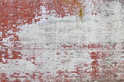 Grungy brick wall background.