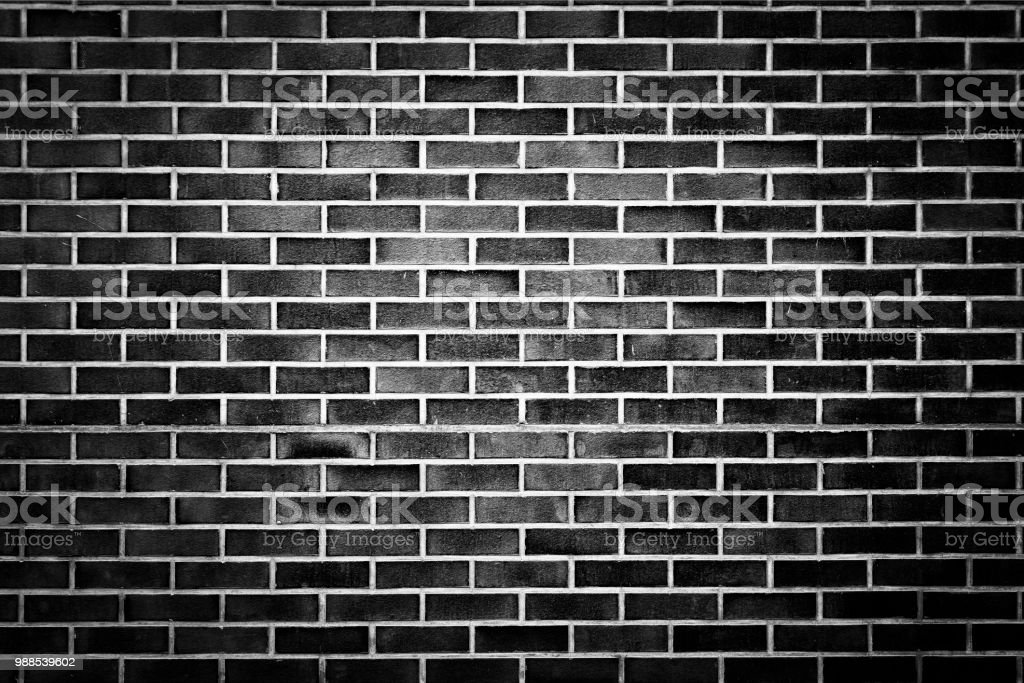 black Rough brick wall, texture, light accent in the center