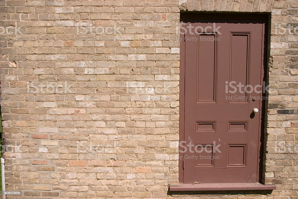 Brick Wall Brown Door royalty-free stock photo