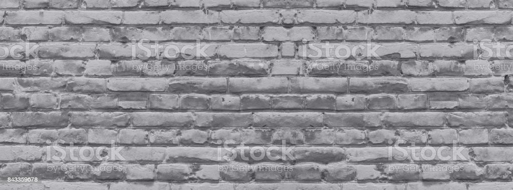 brick wall covered with neutral gray lime stock photo
