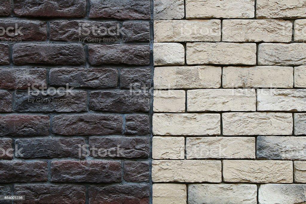 Brick wall is half black, half white stock photo