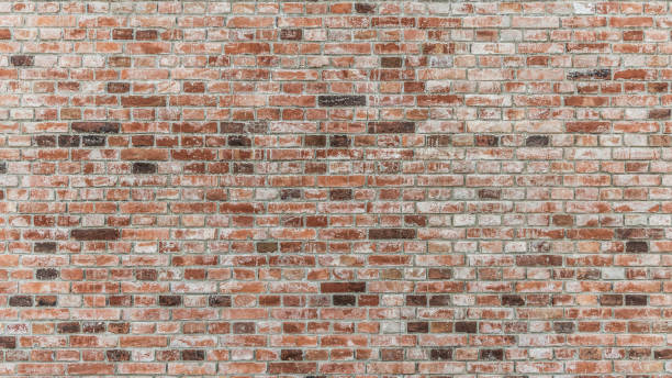 Brick wall of red color, old red brick wall texture background. stock photo