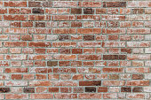 istock Brick wall of red color, old red brick wall texture background. 1140379478