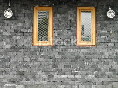 istock brick wall of with window, modern style 1003898702