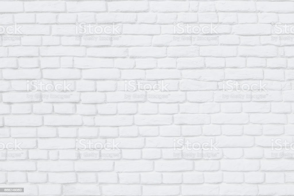 Brick wall painted white lime as a background or backdrop stock photo