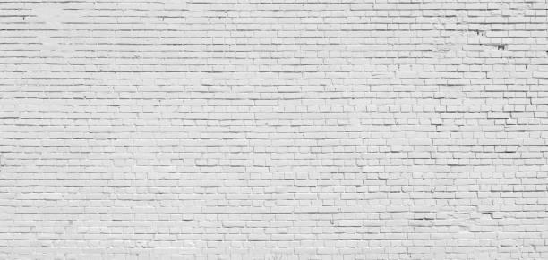 mur de briques blanches peint à la peinture. - brique photos et images de collection
