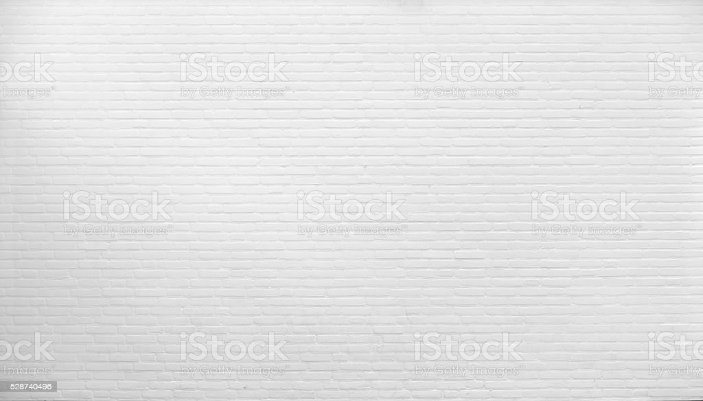 Brick wall painted with white paint. stock photo