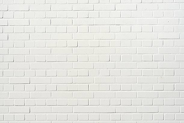 brick wall A white brick wall with copy space. brick stock pictures, royalty-free photos & images