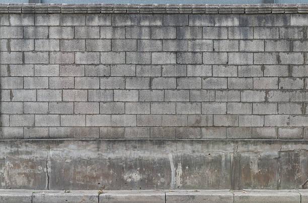 brick wall - betonblock wände stock-fotos und bilder