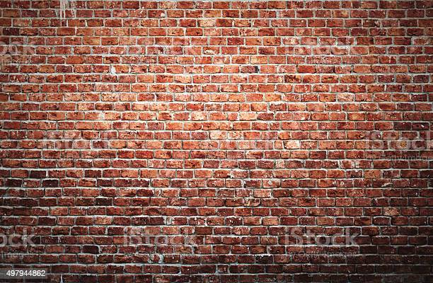 Old brick wall background with vignette effect.