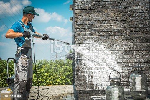 istock Brick Wall Pressure Washing 1131454238