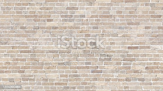 istock Brick wall seamless texture. Beige stone pattern background 1224390484