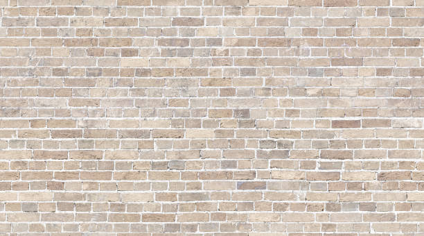 Brick wall seamless texture. Beige stone pattern background Beige Brick wall seamless pattern background. Whitewashed stone texture background brick stock pictures, royalty-free photos & images