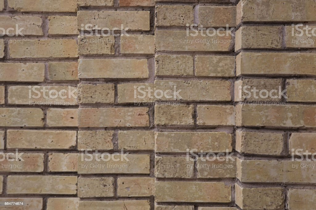 Brick wall staggered beige stock photo