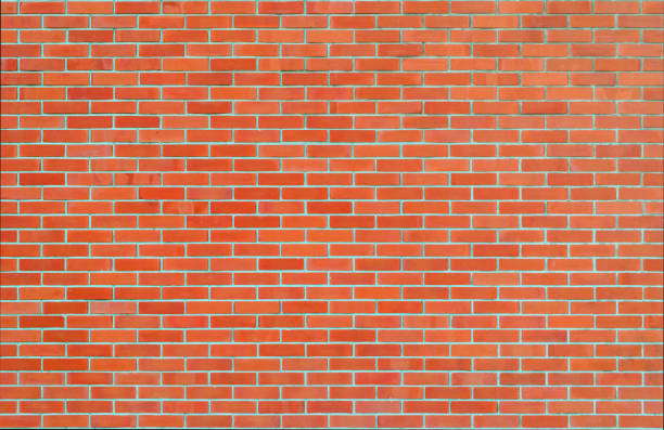 Brick wall texture background in red tone stock photo