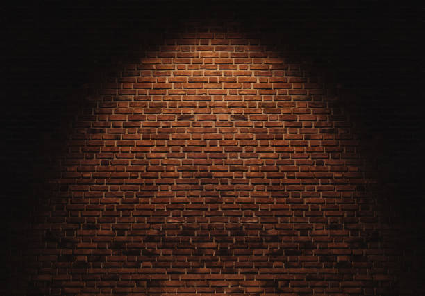 Brick wall texture backgrounds, with light spot stock photo