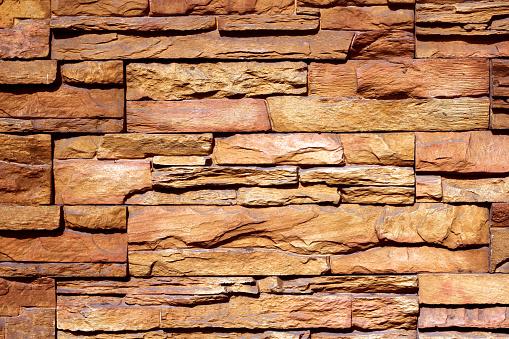 Brick wall texture grunge background, brown stone wall background